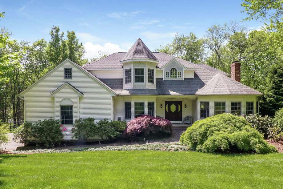 Built in 1993 by the current owners, the 3,995-square-foot home is idyllically sited on 2.15 level acres at 10 Southridge Road, a quiet cul-de-sac in desirable Southridge Estates in Southbury. Photo: William Pitt Sotheby's International Realty / ONLINE_CHECK