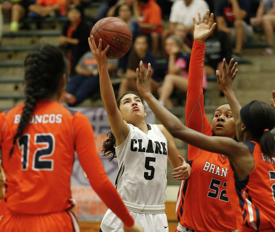 Clark's Jessica Paz Y Puente (05) attempts a score against Brandeis' Cindy Si (12), Breauna Delon (52) and Brianna Walker (21) in girls basketball at Taylor Fieldhouse on Tuesday, Dec. 22, 2015. Clark defeated Brandeis, 72-60. (Kin Man Hui/San Antonio Express-News) Photo: Kin Man Hui, Staff / San Antonio Express-News / ©2015 San Antonio Express-News