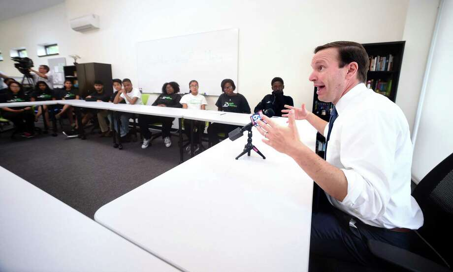 U.S. Sen.  Chris Murphy, right, speaks with teens in the Squash Haven program in New Haven about gun violence Monday. Photo: Arnold Gold / Hearst Connecticut Media / New Haven Register