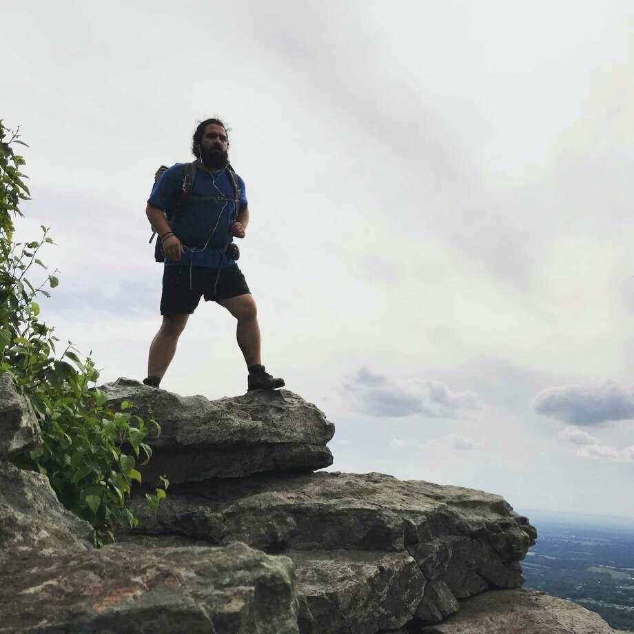 Mark Maynard hiking over Black Rock Cliff in Maryland. Photo: Courtesy Mark Maynard