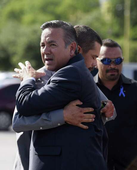 A hearing has rescheduled for Aug. 14 on convicted felon Carlos Uresti's request to start collecting his state pension, which he has valued at more than $80,000 a year. In this June 26 photo, Uresti is embraced by a supporter following his sentencing hearing in San Antonio federal court. Uresti received a 12-year prison term and was ordered to pay $6.3 million in restitution to his victims. Photo: Billy Calzada /Staff Photographer / San Antonio Express-News