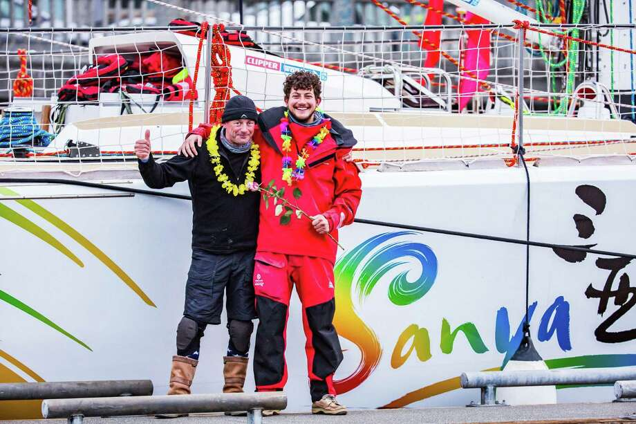 After almost a month at sea, the father and son duo of Benoit, left, and Victor Ansart from Old Greenwich and their Sanya Serenity Coast team crossed the finish line. Photo: Contributed Photo / Contributed Photo / Stamford Advocate Contributed
