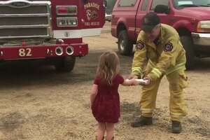 Two-year-old Gracie handed out sandwiches to firefighters battling the Carr Fire Monday morning. A video of the act of kindness went viral on Facebook.