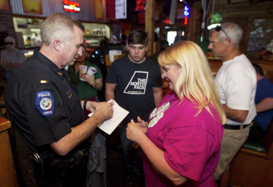 Conroe Police Lt. Jon Buckholtz visits with patrons at Texas Roadhouse on Thursday, July 26, 2018, in Conroe. Local law enforcement collected donations for Special Olympics Texas, an organization that provides sports competitions for children and adults with intellectual disabilities. Photo: Jason Fochtman, Staff Photographer / Houston Chronicle / © 2018 Houston Chronicle