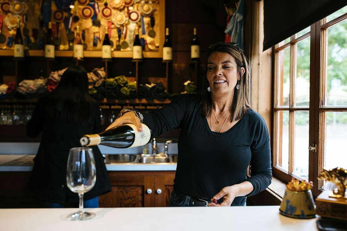 Julia Bloyd pours wine at the Navarro Vineyards in Philo, Calif., on Saturday, May 26, 2018.