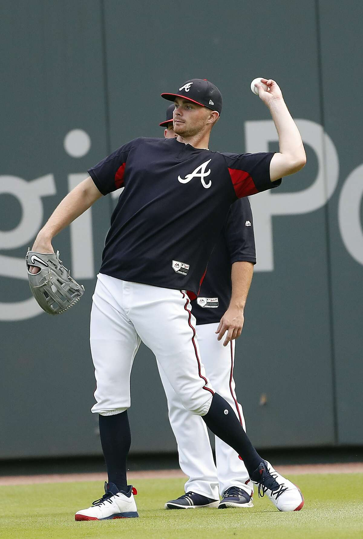 Atlanta Braves starting pitcher Sean Newcomb (15) throws a ball in from the outfield before of a baseball game against the Miami Marlins Monday, July 30, 2018 in Atlanta. Newcomb apologized Sunday for racist, homophobic and sexist tweets he sent as a teenager, calling them