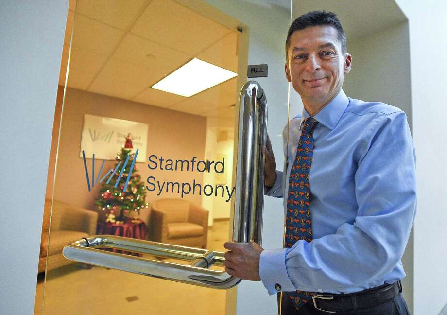 FILE — Russell Jones, new executive director of the Stamford Symphony, is photographed on Dec. 21, 2017 at the symphony offices in Stamford. He's a longtime orchestra administrator who moved from the United Kingdom over a decade ago and will be taking over for Barbara Soroca, who is retiring after 30 years. Photo: Matthew Brown / Hearst Connecticut Media / Stamford Advocate