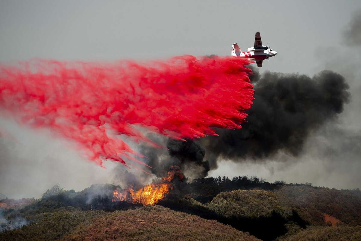 An air tanker drops retardant on a wildfire burning near Lakeport, Calif. on Monday, July 30, 2018.