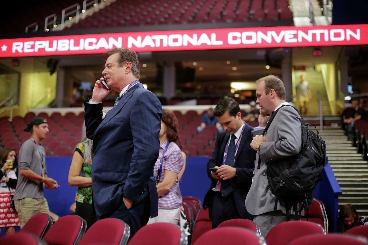 FILE -- Then-presidential candidate Donald J. Trump's campaign manager, Paul Manafort, talks on the phone before the Republican National Convention in Cleveland, July 17, 2016. As Manafort's trial continues, questions about Russian involvement in Trump?'s 2016 campaign are not on the docket, but hang heavily over the proceedings. (Sam Hodgson/The New York Times)