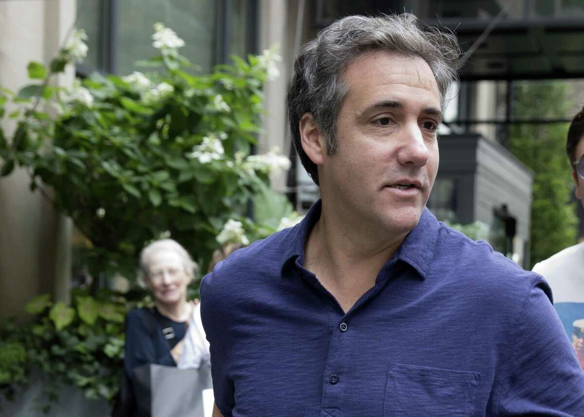 Michael Cohen, formerly a lawyer for President Donald Trump, leaves his hotel Monday, July 30, 2018, in New York. Cohen, claims Trump knew in advance about a Trump Tower meeting in June 2016 between a Russian lawyer, Trump's eldest son and aides. (AP Photo/Richard Drew)