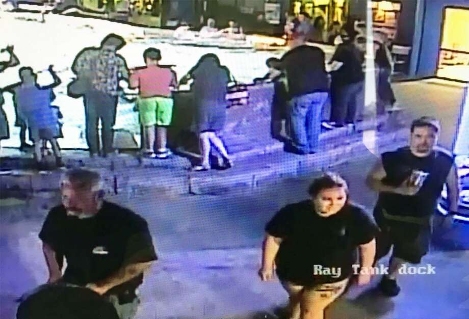Police released a shot from a surveillance video of two men and a woman that have been linked to the theft of a gray horn shark from the San Antonio Aquarium. One of the men was seen on surveillance video reaching into the tank and removing the shark from the exhibit. Photo: Leon Valley Police Department