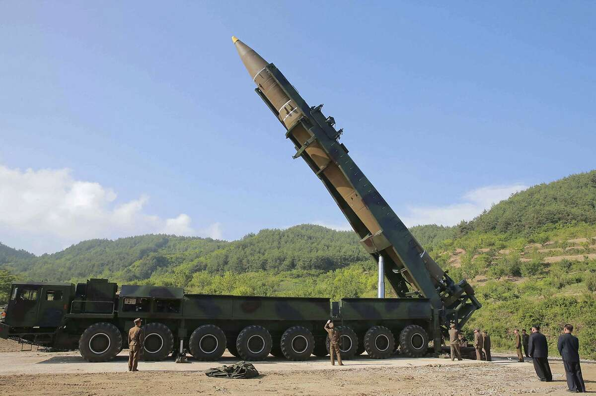 FILE - In this July 4, 2017, file photo distributed by the North Korean government, North Korean leader Kim Jong Un, second from right, inspects the preparation of the launch of a Hwasong-14 intercontinental ballistic missile (ICBM) in North Korea's northwest. Recent media reports citing intelligence assessments suggest North Korea is continuing to build and improve the infrastructure for its nuclear and missile programs. (Korean Central News Agency/Korea News Service via AP, File)