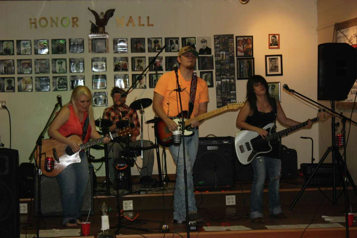 The Rebel Download Band rocked the American Legion Harold G. Davis Post 629 during the 143rd birthday celebration of San Jacinto County.