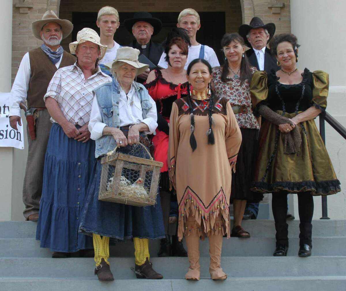 Characters from the upcoming Heritage Days event made an appearance during the first day of the San Jacinto County 145th anniversary celebration. Back row: Anthony Martinez, Avery Hickman, Dale Everitt, Aston Hickman and Wes Rogers. Middle row: Pam Jackson, Brenda Aucoin, Kathy Lewis and Marsha Paige. Front row: Dot Garland and Anita Nalson.