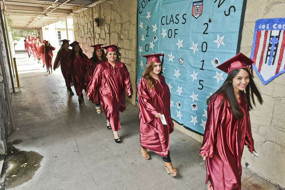 Laredo Job Corps don their cap and gown, Friday afternoon, as the graduates head towards their ceremony at the Laredo Job Corps campus. Photo: Danny Zaragoza, Staff Photographer / LAREDO MORNING TIMES