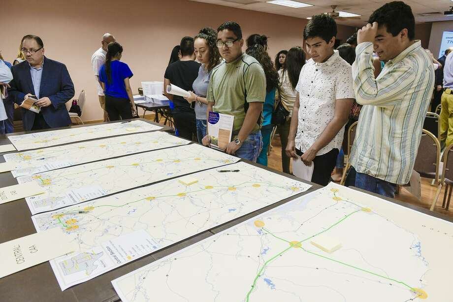 Laredo Community College students revise maps of proposed routes for the Texas-Oklahoma Passenger Rail Study, Tuesday evening at the Texas Department of Transportation Laredo District office during a public meeting held for members of the community to voice their comments. Photo: Danny Zaragoza, Staff Photographer / Laredo Morning Times