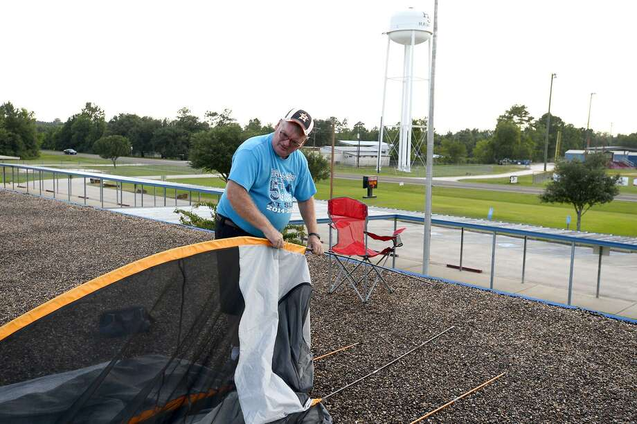George Jordan, a fifth grade science teacher, sets up his tent on the roof of Sour Lake Elementary School. Jordan has made it a tradition to spend a night on the school's roof if more than 90 percent of his students pass their STAAR test. Photo: Ryan Pelham / The Enterprise / ©2018 The Beaumont Enterprise