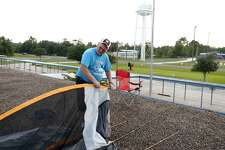 George Jordan, a fifth grade science teacher, sets up his tent on the roof of Sour Lake Elementary School. Jordan has made it a tradition to spend a night on the school's roof if more than 90 percent of his students pass their STAAR test.