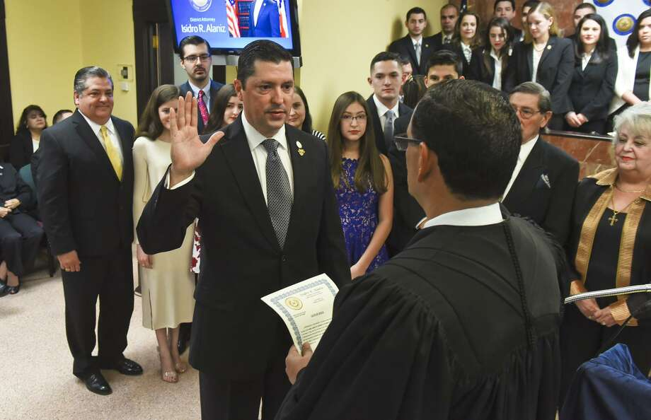 "Isidro ""Chilo"" Alaniz is sworn in as District Attorney by 49th District Court Judge Jose A. Lopez on Sunday morning at the Webb County Justice Center. Photo: Danny Zaragoza, Staff Photographer / Laredo Morning Times / LAREDO MORNING TIMES"