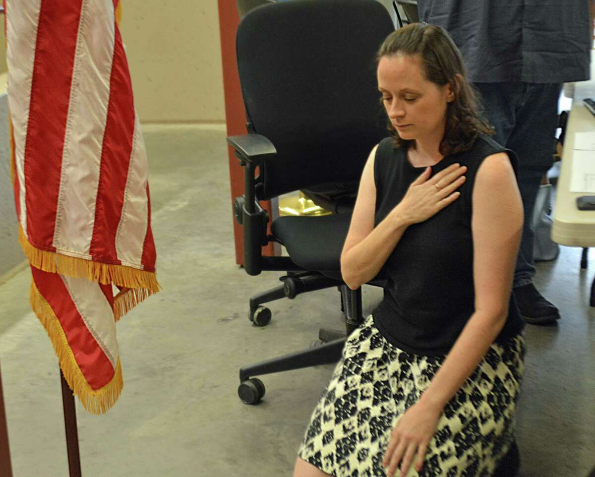 Haddam Selectwoman Melissa Schlag was condemned during the Board of Selectmen's meeting Monday night, as person after person spoke against her taking a knee two weeks ago when the Pledge of Allegiance was recited.