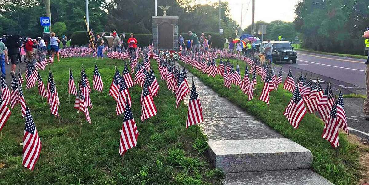 A pro-American flag rally was held Friday night near the town green, where 1,000 flags were placed on the grass. Those who attended were showing solidarity in response to Haddam Selectman Melissa Schlag's kneeling during the Pledge of Allegiance July 16.