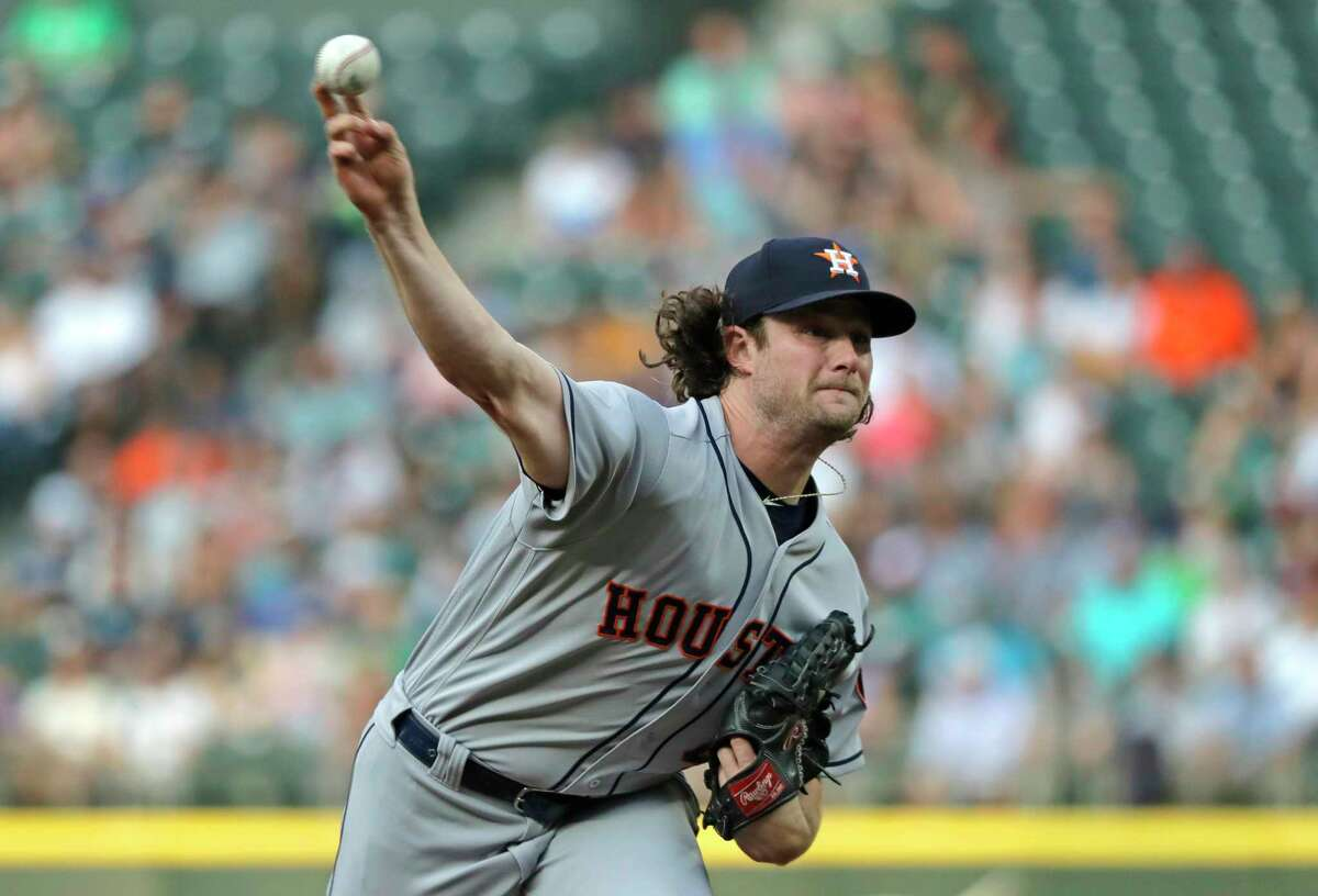 Houston Astros starting pitcher Gerrit Cole throws against the Seattle Mariners during the first inning of a baseball game, Monday, July 30, 2018, in Seattle. (AP Photo/Ted S. Warren)