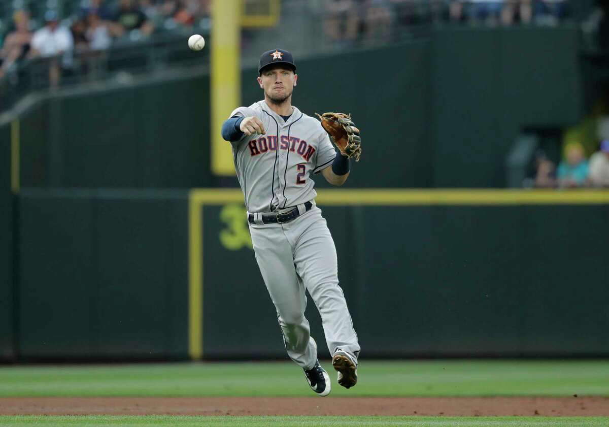 Houston Astros shortstop Alex Bregman fields a ground out hit by Seattle Mariners' Ryon Healy in the third inning of a baseball game, Monday, July 30, 2018, in Seattle. (AP Photo/Ted S. Warren)