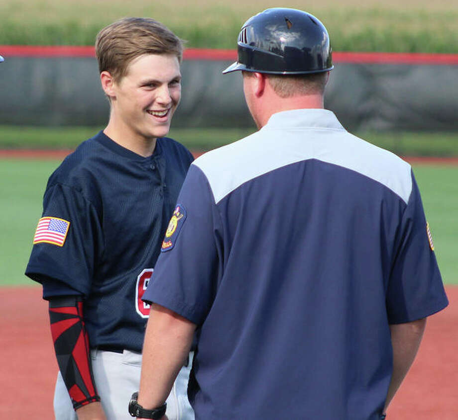Alton Post 126's Ben Mossman talks with manager Nick Paulda during a pitching change for Newton after Mossman's RBI single in the sixth inning extended Alton's lead to 4-2 in Monday's victory in the Senior Legion state tournament at SIUE's Simmons Baseball Complex in Edwardsville. Photo:       Greg Shashack / The Telegraph