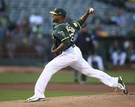 Oakland Athletics pitcher Edwin Jackson works against the Toronto Blue Jays in the first inning of a baseball game Monday, July 30, 2018, in Oakland, Calif. (AP Photo/Ben Margot)