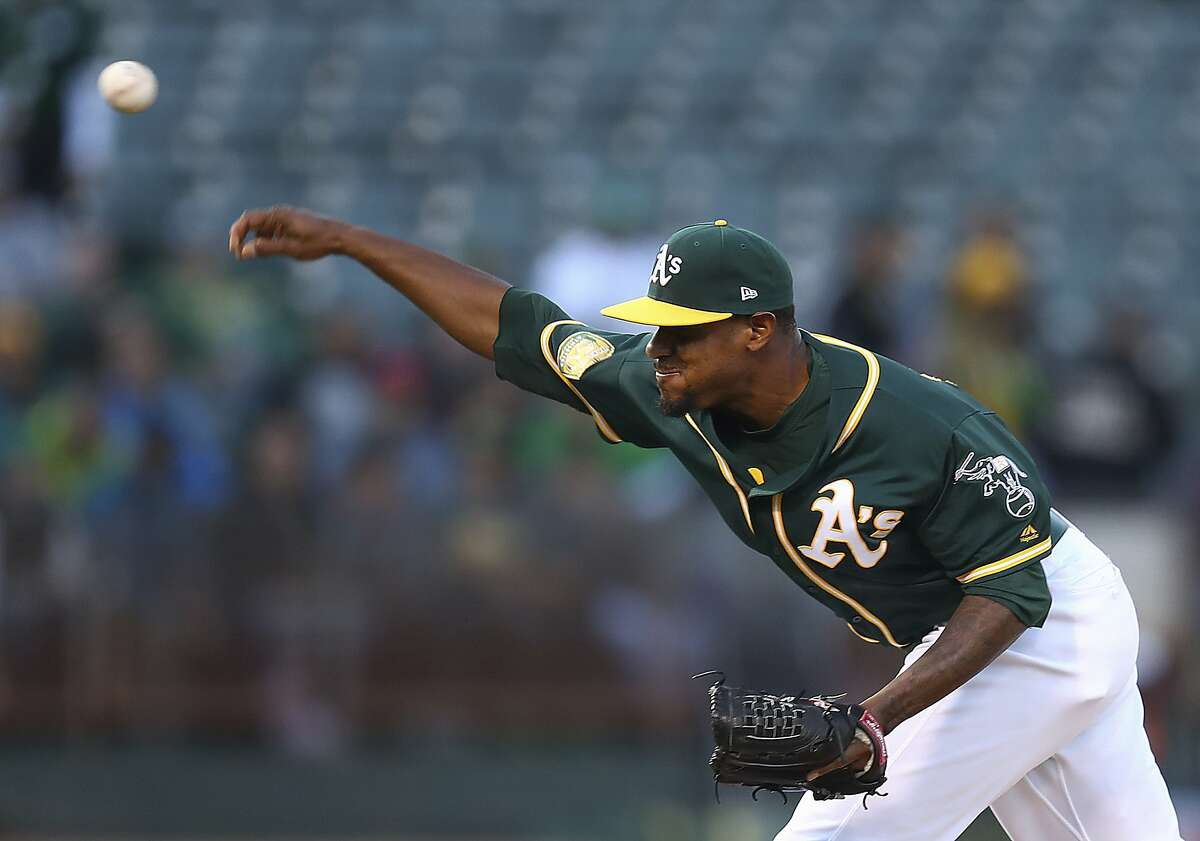 Oakland Athletics pitcher Edwin Jackson works against the Toronto Blue Jays in the first inning of a baseball game Monday, July 30, 2018, in Oakland, Calif.