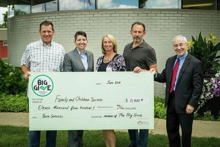 From left, John Wilson, Denise Berry, Betty O'Neill, Jesse Traschen and Jim Nigro participate in a ceremony as The Big Give donates $11,400 to Family and Children's Services of Midland. (Photo provided)