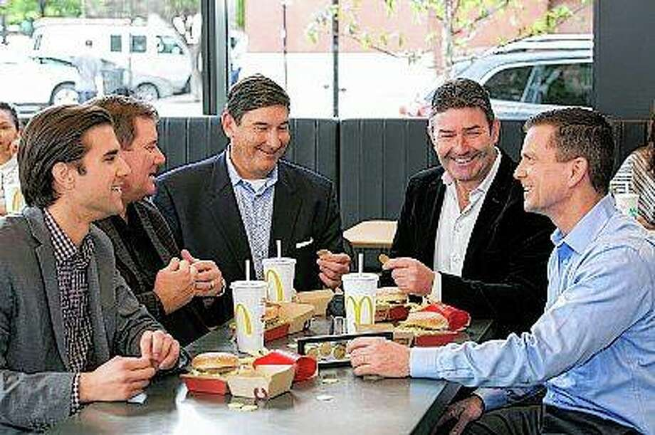 McDonald's CEO Steve Easterbrook (fourth from left) and McDonald's franchisees Nick, Dan, Mike and Tony Delligatti, grandsons and son of the late inventor of the Big Mac, Jim Delligatti, enjoy a lunch of Big Macs while admiring the MacCoin at McDonald's global restaurant in Chicago. Photo:       Peter Wynn Thompson | AP Images For McDonald's