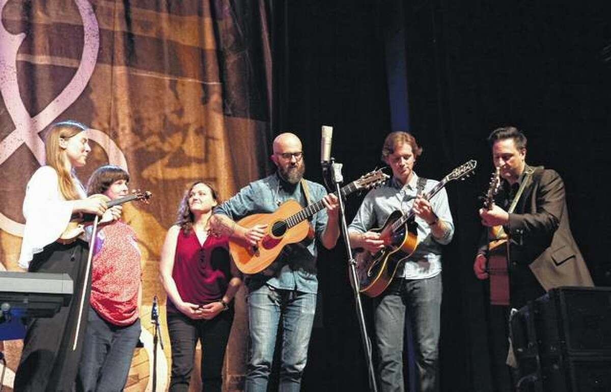 William Fitzsimmons (center) and Stuart Smith (second from right) perform at the Ryman Auditorium in Nashville, Tennessee. Joining them on stage for Fitzsimmons' set were Abby Gundersen (from left), Rosie Thomas, Allie Moss and Adam Landry. Smith lives in Winchester. Until recently, Fitzsimmons called Jacksonville home.