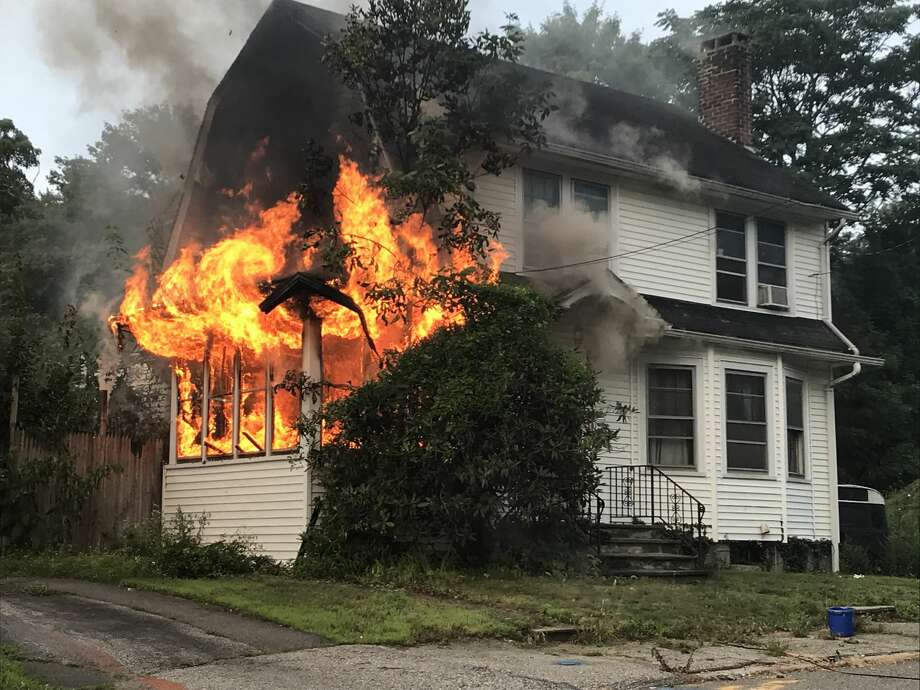 Two adults and a dog escaped a fire in this Wesley Street home in Ansonia on Tuesday morning. Photo: Contributed Photo