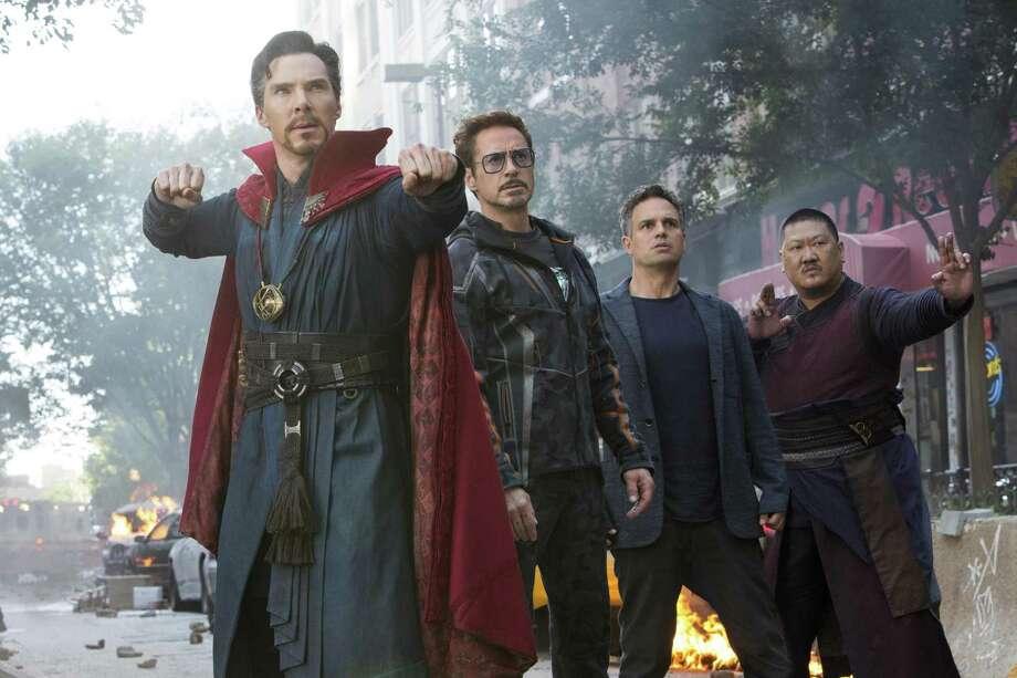 "Doctor Strange (Benedict Cumberbatch, left, with Robert Downey Jr., Mark Ruffalo and Benedict Wong) sound the alarm in ""Avengers: Infinity War."" Photo: Marvel Studios / Disney-Marvel"