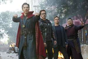 """Doctor Strange (Benedict Cumberbatch, left, with Robert Downey Jr., Mark Ruffalo and Benedict Wong) sound the alarm in """"Avengers: Infinity War."""""""