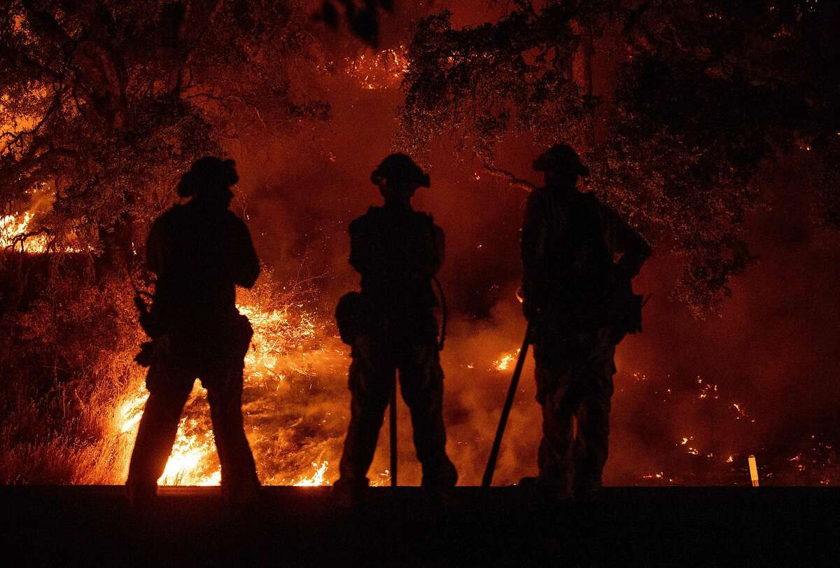 Firefighters watch a back burn during the Mendocino Complex fire in Upper Lake, California on July 31, 2018. The Mendocino Complex -- made up of two fires -- has burned more than 24,000 acres in total since July 27. Thousands of firefighters in California made some progress against several large-scale blazes that have turned close to 200,000 acres (80,940 hectares) into an ashen wasteland, destroyed expensive homes, and killed eight fire personnel and civilians in the most populous US state. / AFP PHOTO / JOSH EDELSONJOSH EDELSON/AFP/Getty Images