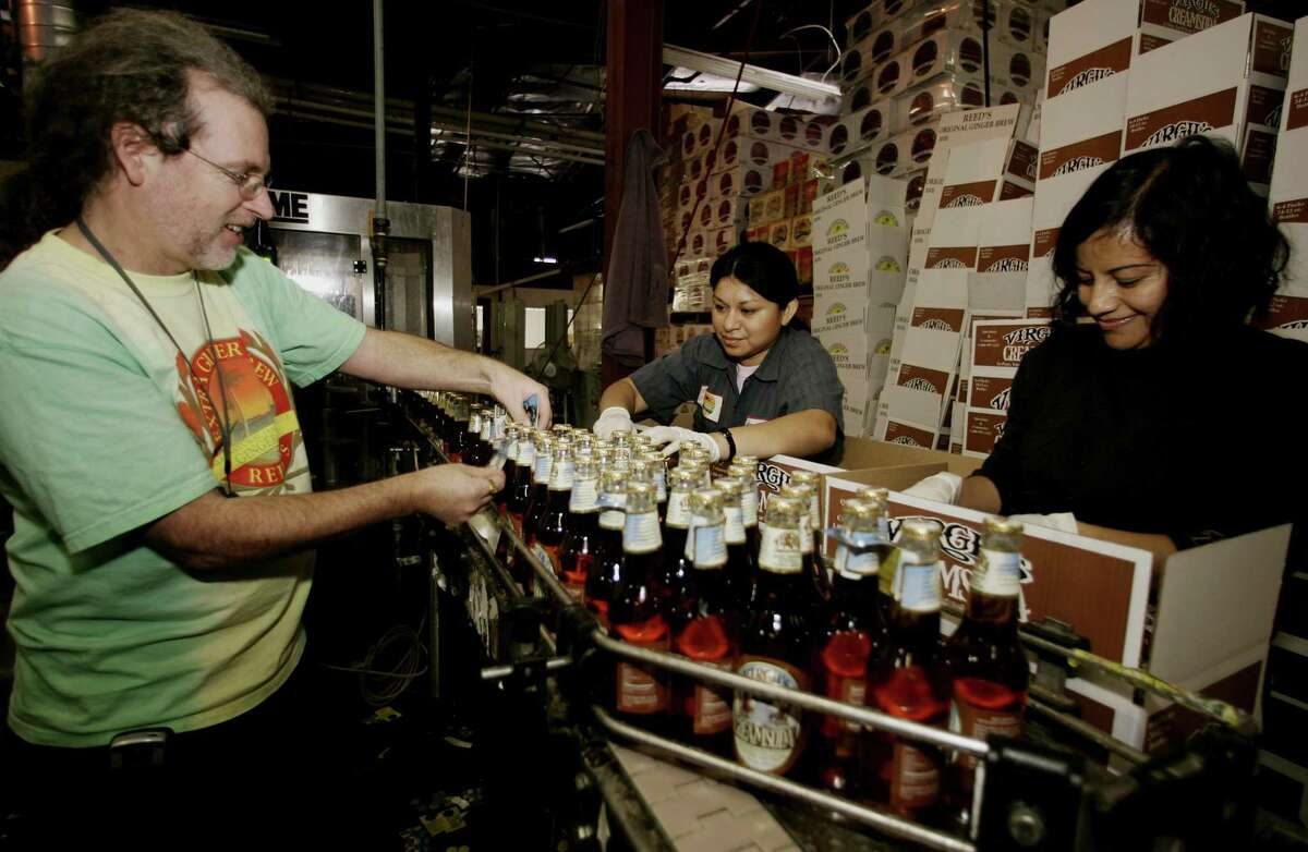A file photo of Reed's founder Chris Reed on his company's former Los Angeles ginger beer production line. Reed's announced on July 31, 2018 the relocation of its headquarters to Norwalk, Conn. after the sale of the Los Angeles plant. (AP Photo/Damian Dovarganes)