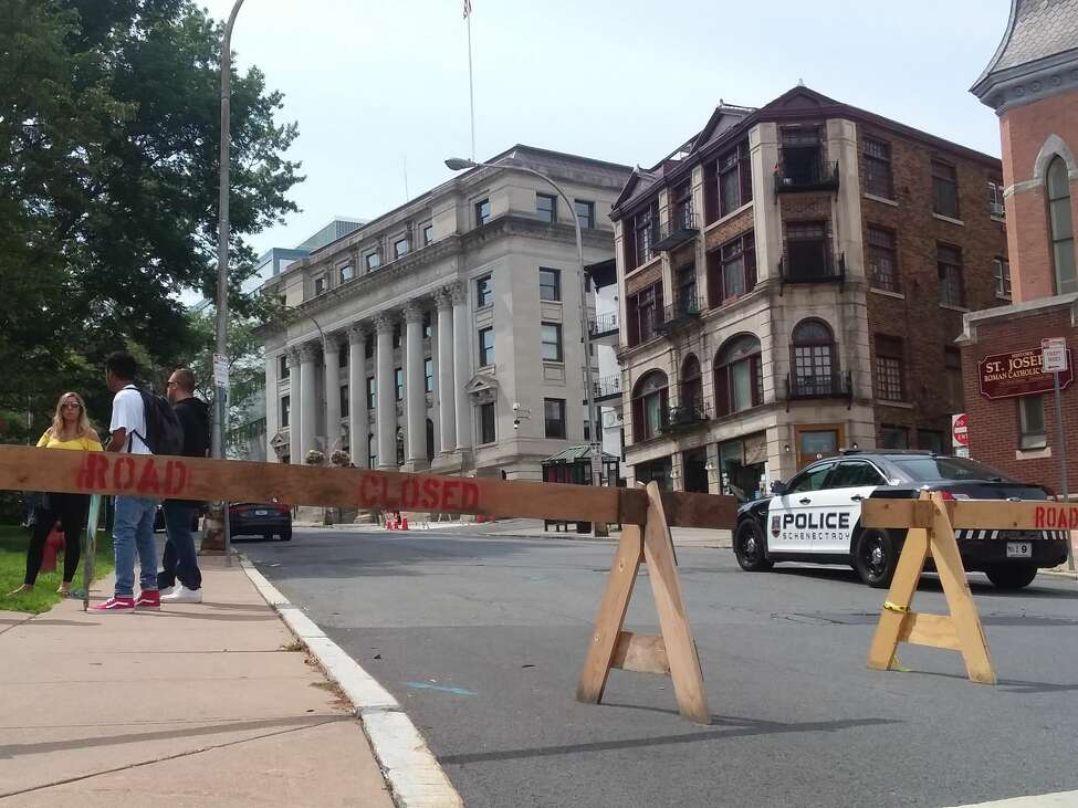 Barriers are set up in downtown Schenectady on Tuesday, July 31, 2018, after city hall, the county courthouse and several other government buildings were evacuated when a threatening note was found. (Kellen Riell/Times Union)