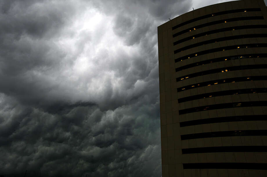 Storm clouds roll past Edison Plaza in downtown Beaumont.   Photo taken Tuesday 7/31/18 Ryan Pelham/The Enterprise Photo: Ryan Pelham/The Enterprise / ?2018 The Beaumont Enterprise