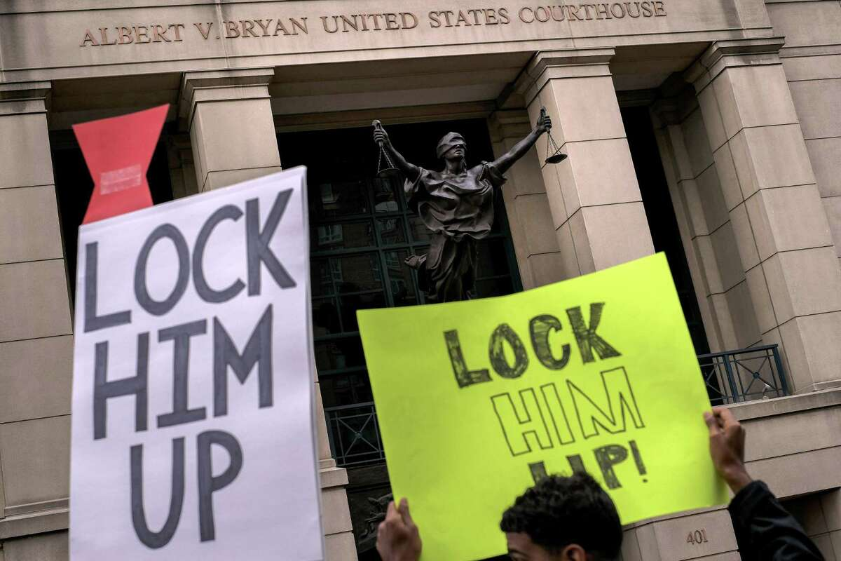 Protesters outside the federal courthouse where Paul Manafort, President Donald Trump's former campaign chairman, was to begin his trial Tuesday, in Alexandria, Va., July 31, 2018. Jury selection began Tuesday in Manafort's bank and tax fraud trial. President Donald Trump?'s former campaign chairman is the first American charged in Robert Mueller's inquiry. (Gabriella Demczuk/The New York Times)