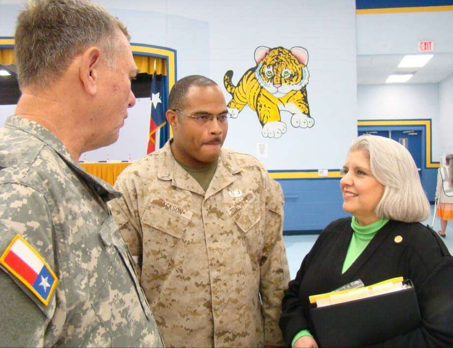 Senator Judith Zaffirini champions critical health care services for all Texans. Above, she meets with members of the military at Operation Lone Star. This annual joint effort of state agency and military personnel, local health care leaders, and volunteers provides free medical services to underserved communities in South Texas. Photo: Charles, Stefanie