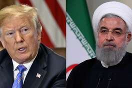 "(COMBO) This combination of pictures created on July 23, 2018 shows US President Donald Trump speaks during a cabinet meeting on July 18, 2018, at the White House in Washington, DC. AND In this file photo taken on May 2 2018, a handout picture provided by the Iranian presidency on shows President Hassan Rouhani giving a speech on Iranian TV in Tehran. US President Donald Trump has launched a exceptionally raw attack on Iran, in a tone reminiscent of his war on words with North Korea last year -- sparking questions about US strategy towards the the Islamic republic. The threatening tweet, sent late on July 22, 2018 and written in all capital letters, was quickly hailed Monday by Israeli Prime Minister Benjamin Netanyahu, who praised the US leader's ""tough stand."" / AFP PHOTO / AFP PHOTO AND IRANIAN PRESIDENCY / Nicholas Kamm AND HO / === RESTRICTED TO EDITORIAL USE - MANDATORY CREDIT ""AFP PHOTO / HO / IRANIAN PRESIDENCY"" - NO MARKETING NO ADVERTISING CAMPAIGNS - DISTRIBUTED AS A SERVICE TO CLIENTS ===NICHOLAS KAMM,HO/AFP/Getty Images"