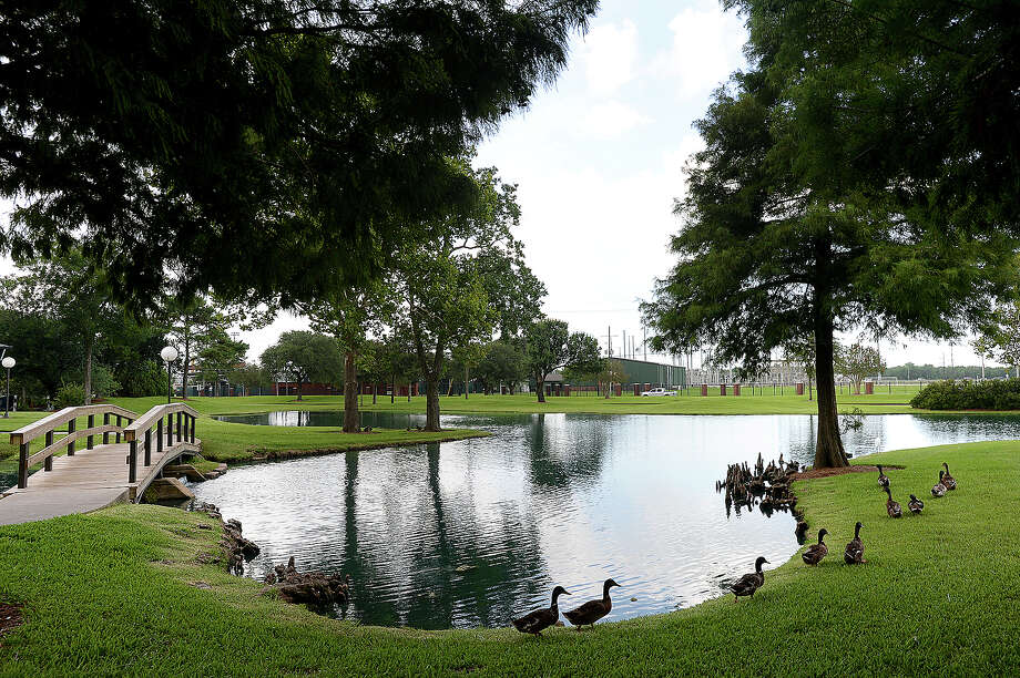The John Gray Center pond is among the many beautification projects undertaken by Lamar University President Ken Evans' wife Nancy, who passed away last month following a long battle with cancer. The walls of the pond were redone and islands built to attract wildlife back to the area. Wednesday, July 11, 2018 Kim Brent/The Enterprise Photo: Kim Brent/The Enterprise