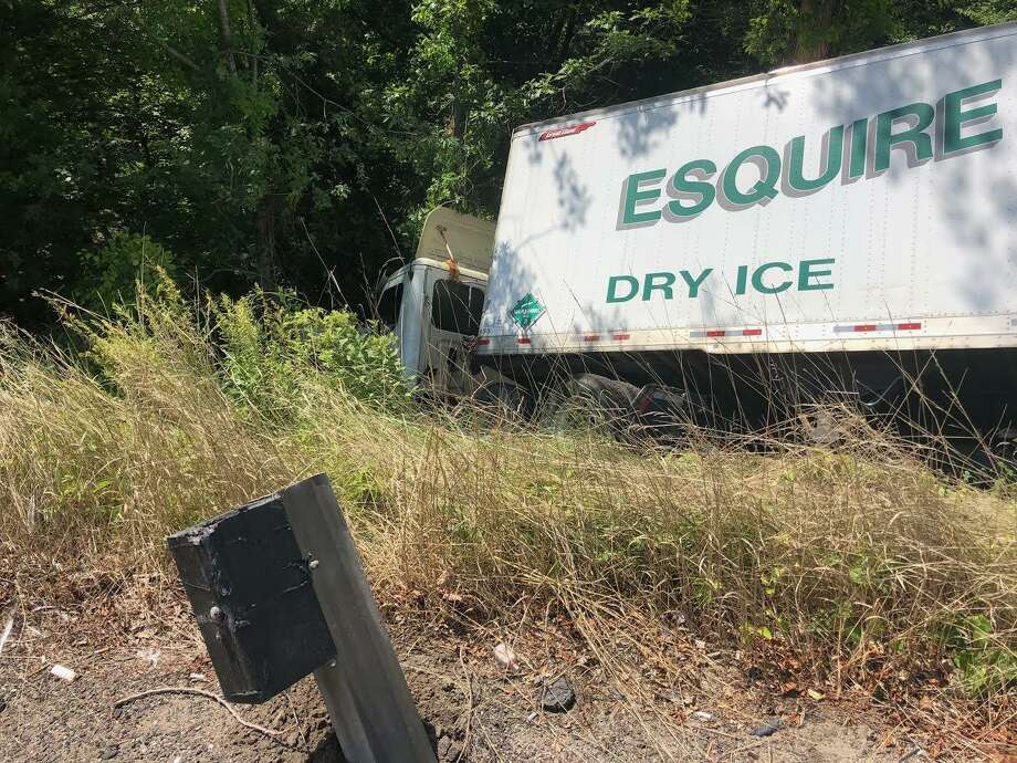Middletown firefighters responded to an Esquire Dry Ice tractor-trailer rollover Tuesday on Route 9 between Exits 10 and 11 which shut down all northbound traffic and reduced southbound lanes to a single one. Photo: Contributed Photo