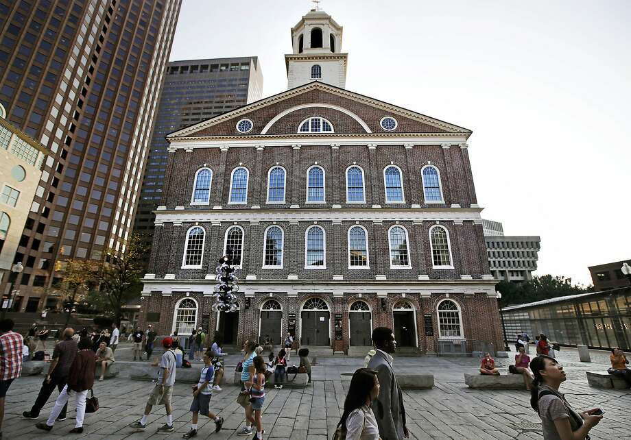 Pedestrians walk past Faneuil Hall. In an open letter to Boston Mayor Marty Walsh, some black Bostonians are threatening a boycott because the building's namesake was a slave owner. Photo: Charles Krupa / Associated Press