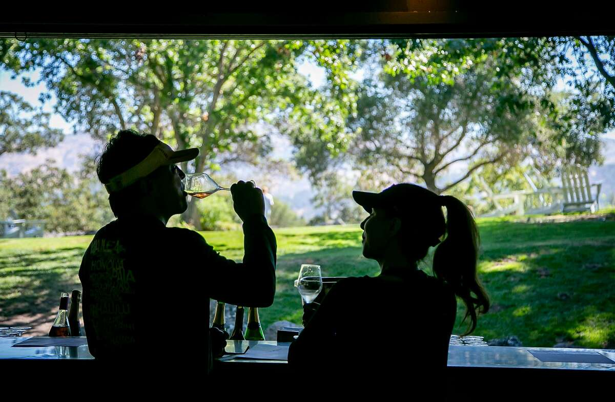 People have wine in the tasting room of Domaine Chandon in Yountville, Calif. on July 24th, 2018.