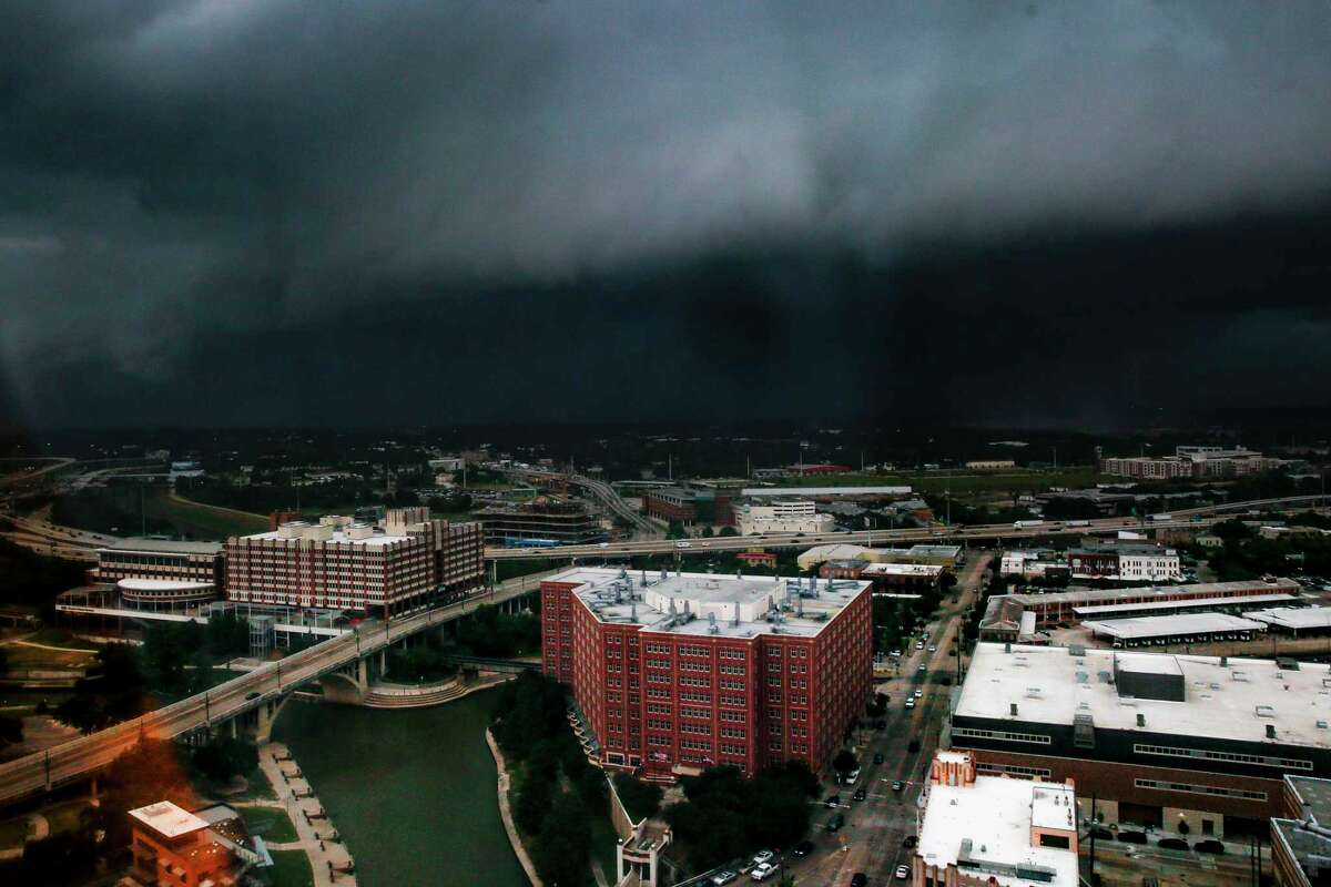 A storm moves into downtown Houston Tuesday July 31, 2018. >>Texas memes to make you smile about the weather for once.