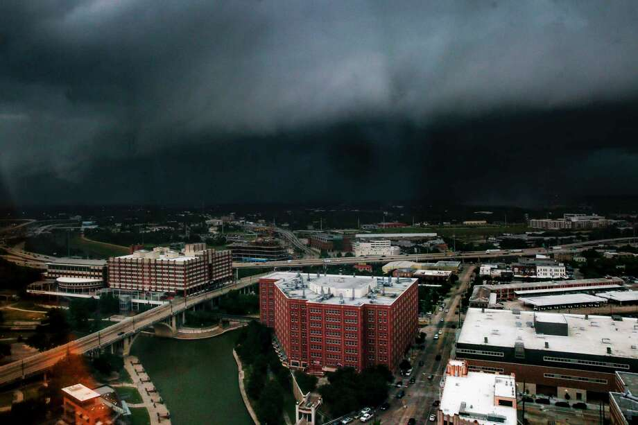 A storm moves into downtown Houston Tuesday July 31, 2018.