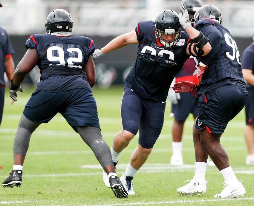 Houston Texans defensive end J.J. Watt (99) bursts between defensive tackle Brandon Dunn (92) and nose tackle D.J. Reader (98) during a drill during training camp at the Greenbrier Sports Performance Center on Tuesday, July 31, 2018, in White Sulphur Springs, W.Va.